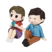 Boy And Girl Sitting Figurine Topper