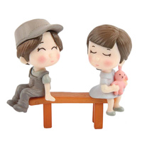 Boy And Girl Seated Figurine Topper