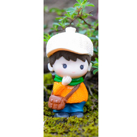 Boy Wearing Orange Jumper Figurine Topper